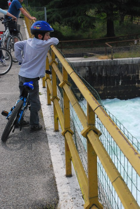 Garda Lake - Young biker on Mincio River